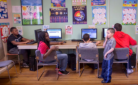 diverse teens in after school program usng technology