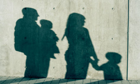 shadow of family on concrete wall