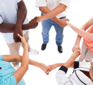 diverse group of adults holding hands