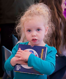 Preschool child holding book