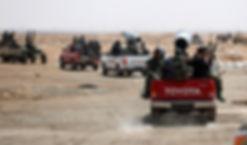Libyan rebels assemble in desert