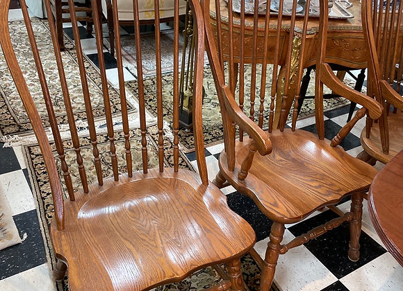 8 Vintage oak Windsor chairs, 2 have arms.Sizable.