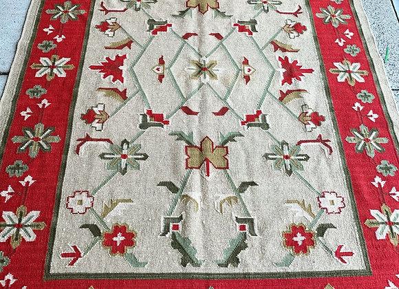 All wool handmade needlepoint rug. 9 x 6