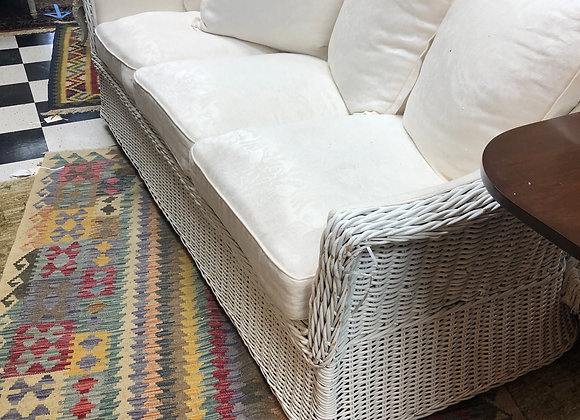"Wicker couch, white damask. 82"" long."