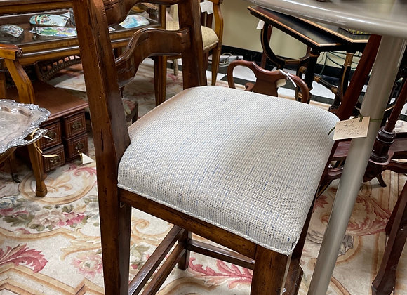 One Barstool by Bausman. Rogers and Goffigan seat..