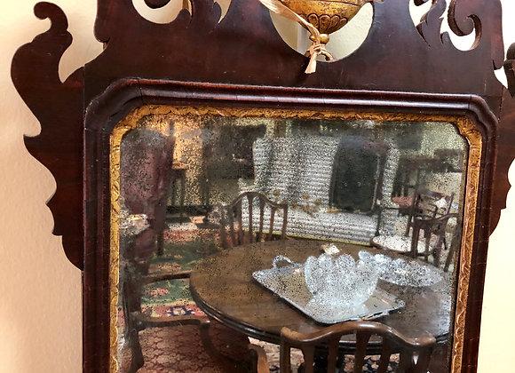Mahogany and gilt mirror. Urn decor.