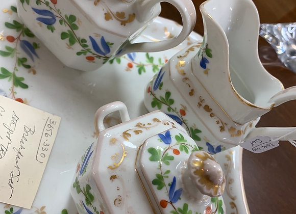 Breakfast tea set. Teapot, cream and sugar. Tray.