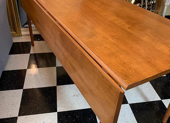 Drop leaf table, sleek clean lines. 6 feet long.