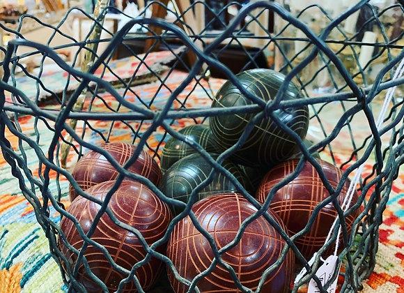 Bocce balls in wire basket