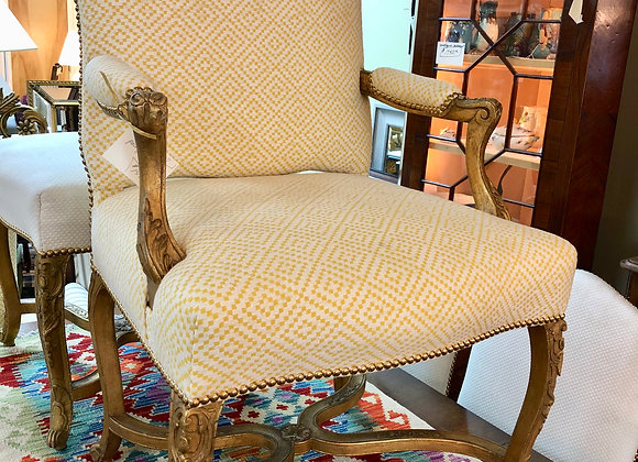 Pair of arm Chairs, brass brads, carved wood.