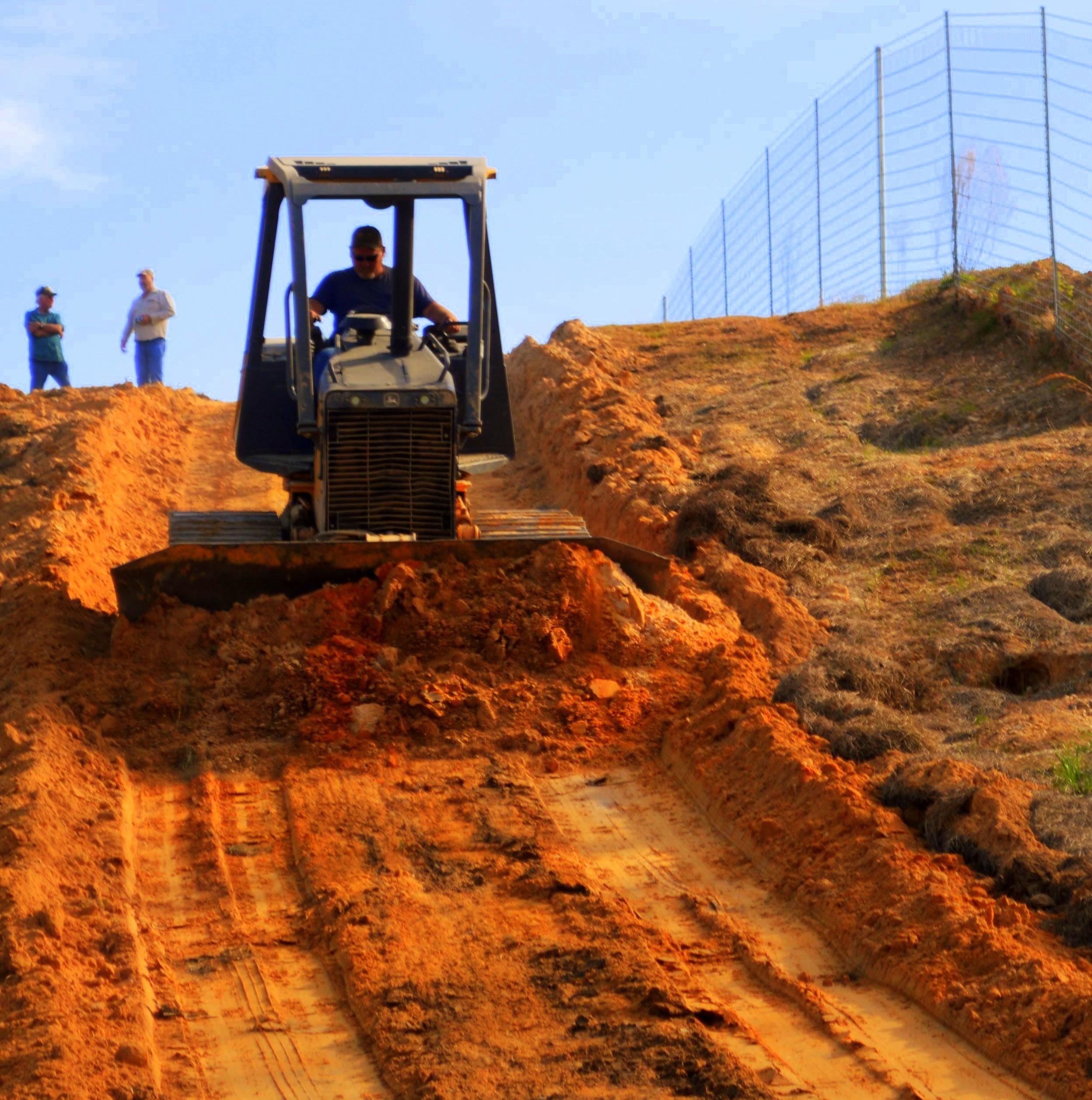 Grading roads in Camilla Cove