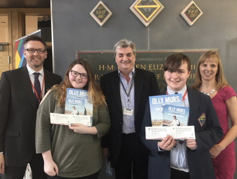Tim Farrer, Senior Deputy Headteacher, Stephen McManus from Stephen C Associates and Hayley Jones, Careers , Advice and Guidance Manager at QE present winning students with their  ckets.