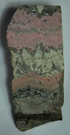 Родонит-родохрозитовые руды с ритмично-полосчатой текстурой
