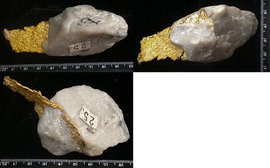 Прожилок золота в кварце.  Выступ пластины золота треугольной формы