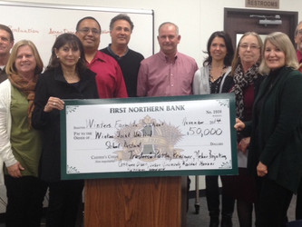 Members of the Winters Farm to School presented a check for $50,000