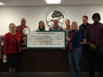 Winters Farm to School presents $60,000 to school board