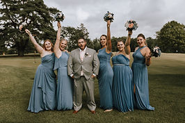 funny groom with bridemaids.jpg