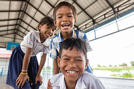 Cambodia_SiemReap_SmallChange_SchoolUniforms_Smile_Hires.jpg