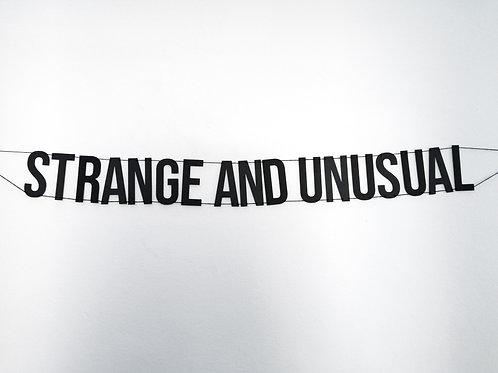 Strange and Unusual Banner