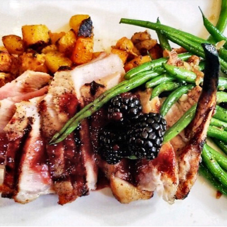French cut pork loin chop with blackberry demi glace, roasted butternut squash and haricot verts