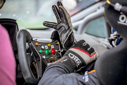 RACING DRIVER IN COCKPIT HAND IN AIR.jpg
