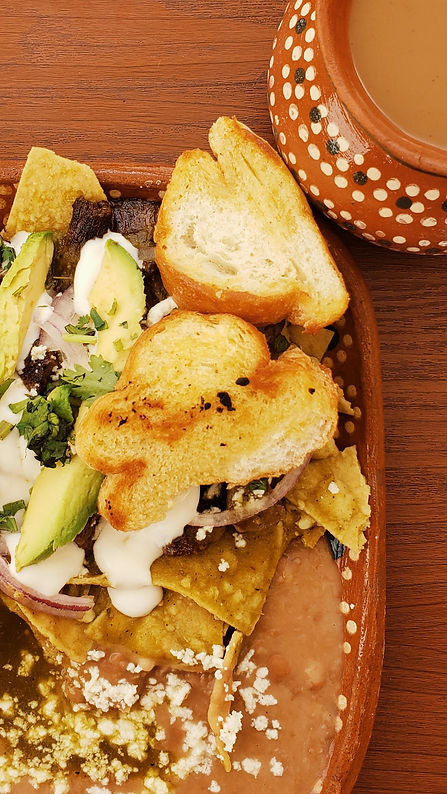chilaquiles-and-beans-on-a-table-with-co
