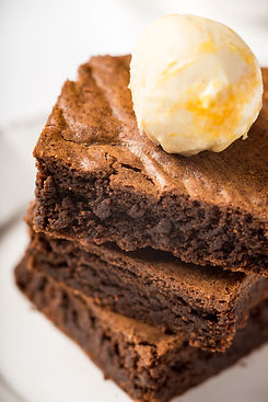 brownie-with-ice-cream-on-a-white-cerami