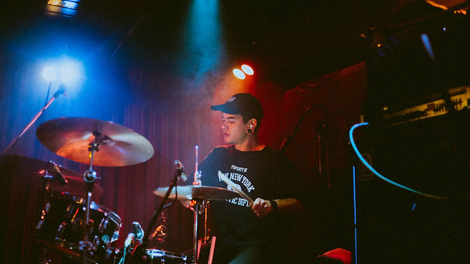 Jack Nelson playing drums with Perth band Scream Mountain