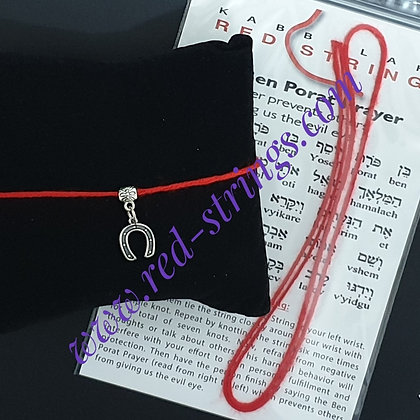 Red string with horseshoe