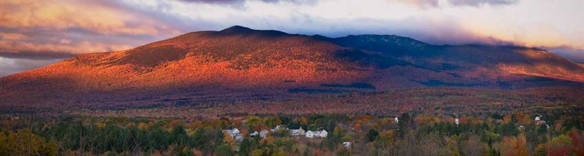 A view of Mt. Abraham from Kingfield, Maine at dawn with fall foliage at its peak.