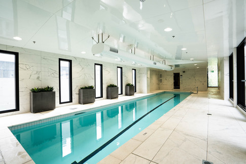 The complex comes with luxurious facilities including a large indoor swimming pool, gym, and shops on the ground floor.