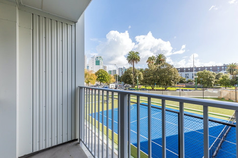 Exquisite north facing balcony over the 'resident-only' tennis court.