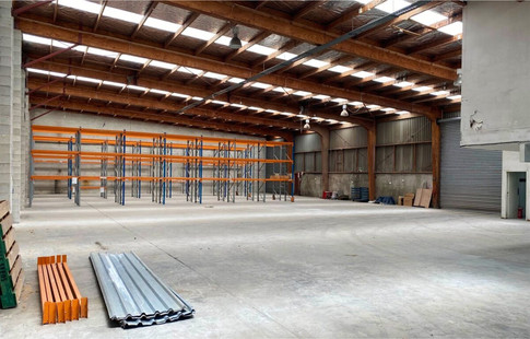 The 671m² warehouse is accessed via 2 roller doors.