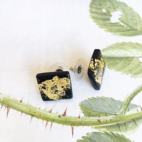 Black and gold stud