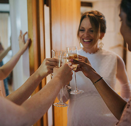 Happy bride at Chafford Park clinking champagne glasses