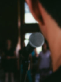 Man speaking in front of the audience