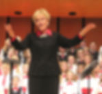 Linda Walker, Artistic Director of Young Artists, conducts the combined children's choruses and audience from throughout Boise Valley in the Concert Finale at Swayne Auditorium, NNU, Nampa, Idaho.