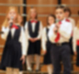 Children sing solos on stage in Young Artists Apprentice Choir Christmas performance at NNU, Nampa, Idaho