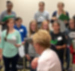 Youth in the children's chorus watch and listen intently during rehearsal with conductor, Linda Walker, as she teaches them to sing the pure, rich sound for which Treasure Valley Young Artists is famous, in their rehearsal at the Nampa Civic Center, Nampa, Idaho.