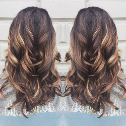 This golden caramel balayage by _amydanielleash is the perfect way to lighten up your dark locks for