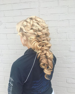 Creative updo done by our bridal specialist Amanda! _#updo #formalstyle #modern #halfuphalfdown #hal