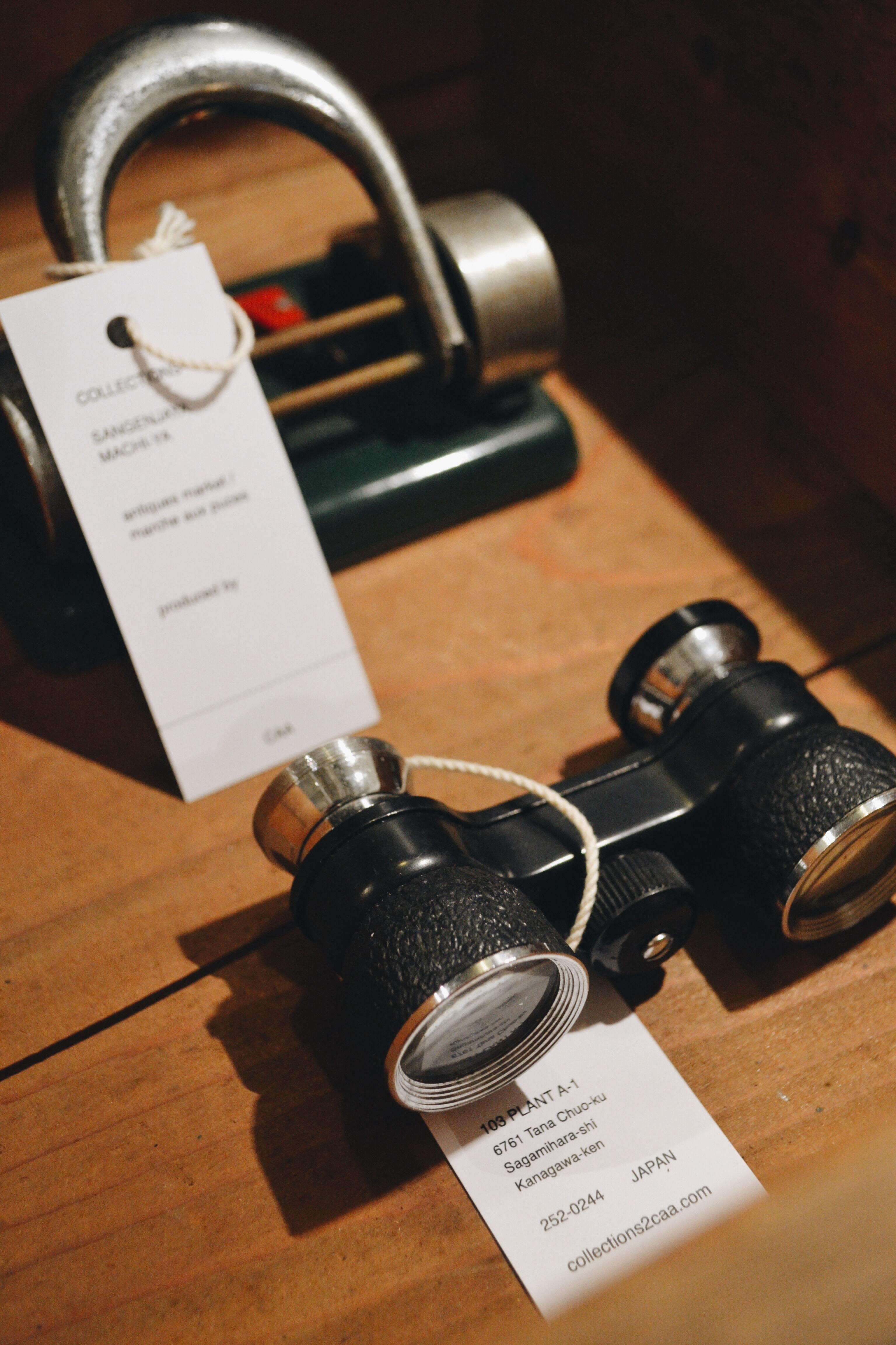 binoculars, hole puncher
