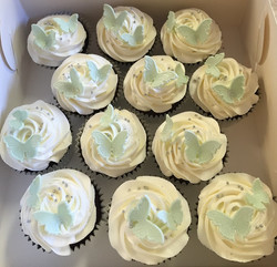 green baby shoes cupcakes