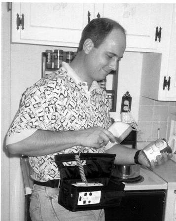 Founder, Dave Raistrick, demonstrating the original barcode scanning device.