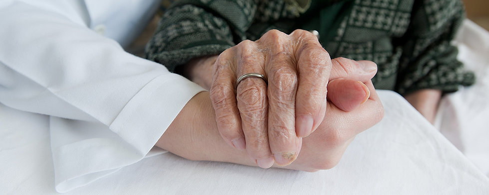 Close up of Elderly woman holding hand with medical suport staff