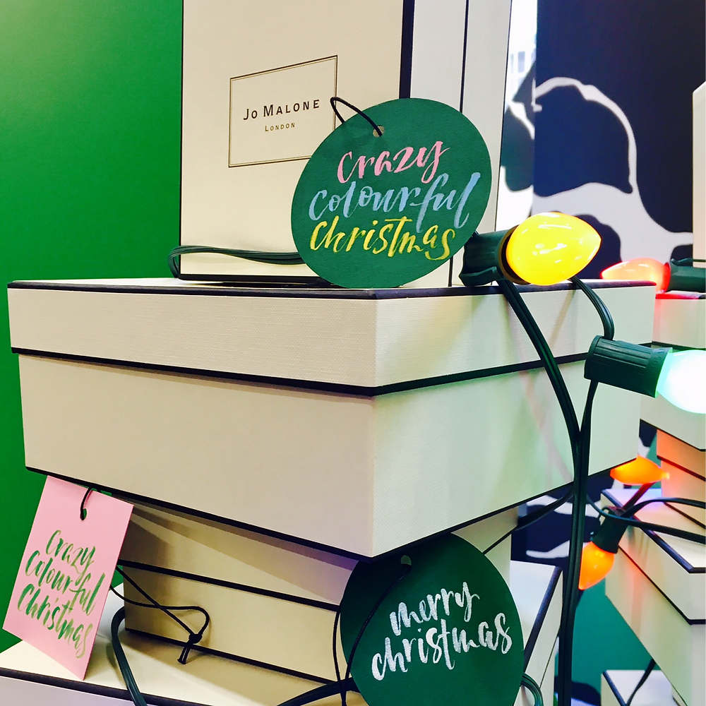 Kirsten Burke creates brush lettering Crazy colourful Christmas campaign.