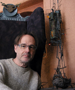 me in wing chair w sculptures d 72