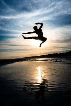 jumping-on-beach