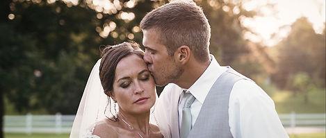 groom-kissing-bride-sunset