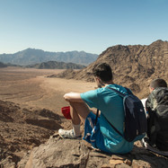 Two of the first group of hikers on the Red Sea Mountain Trail enjoying the view.